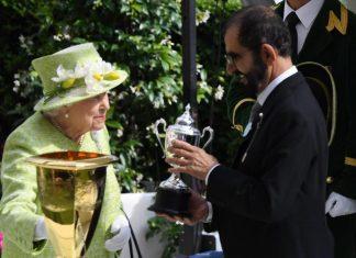 Queen Elizabeth II presents Sheikh Mohammed bin Rashid, Vice President and Ruler of Dubai, with the Diamond Jubilee trophy.
