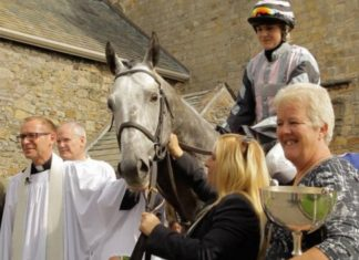 James Moffatt (left) with Cartmel Priory Reverend Nick Devenish at the blessing of the racehorse service.
