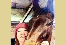 Byrony helping trainer Linda Russell as a stable lass.