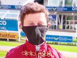 Masked jockey Oisin Murphy.