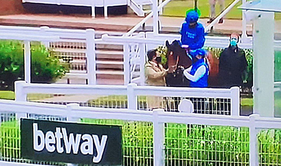 Jockey Buick in the unsaddling enclosure at Newmarket with Boccaccio.