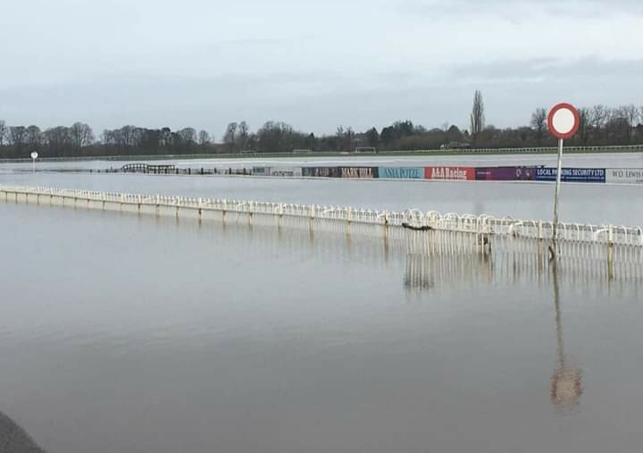 At Worcester racecourse, continuous heavy rain has left the track under water.