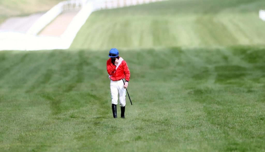 Kennedy as distraught as he made the long walk back to the jockeys room.