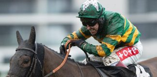 Johnson winning on Dostal Phil at Newbury